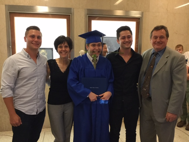 Andrew with his family at graduation