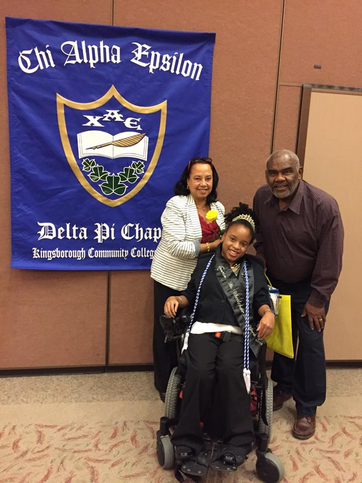 Trina and her parents in front of the Chi Alpha Epsilon banner
